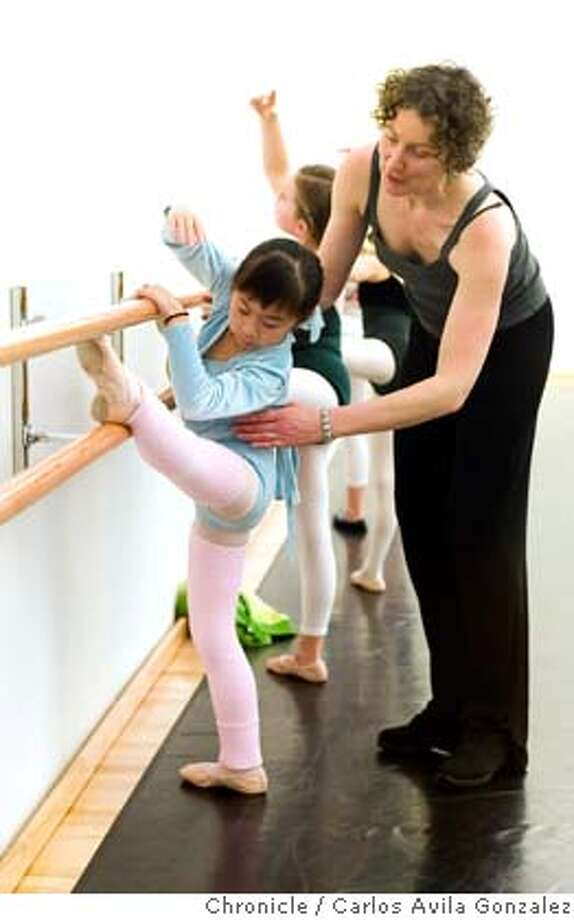 ODC_003_CAG.JPG  Dance teacher, Augusta Moore, instructs Mia Chong during class at the new ODC dance class studio on Thursday, January 12, 2006. A look at ODC's new dance school in San Francisco, Ca.  Photo by Carlos Avila Gonzalez/The San Francisco Chronicle  Photo taken on 01/12/06, in San Francisco, Ca. MANDATORY CREDIT FOR PHOTOG AND SAN FRANCISCO CHRONICLE/ -MAGS OUT Photo: Carlos Avila Gonzalez