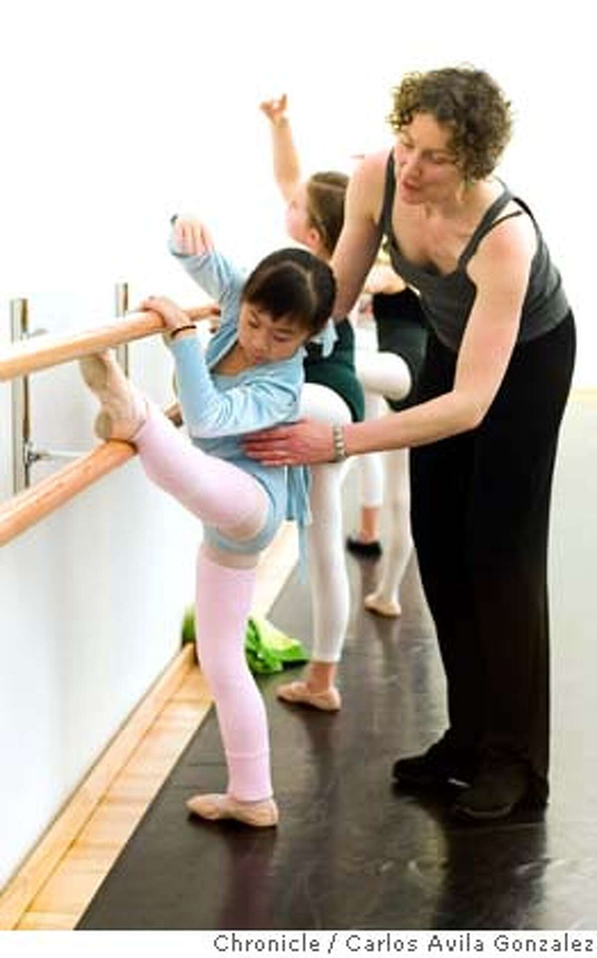 ODC_003_CAG.JPG Dance teacher, Augusta Moore, instructs Mia Chong during class at the new ODC dance class studio on Thursday, January 12, 2006. A look at ODC's new dance school in San Francisco, Ca. Photo by Carlos Avila Gonzalez/The San Francisco Chronicle Photo taken on 01/12/06, in San Francisco, Ca. MANDATORY CREDIT FOR PHOTOG AND SAN FRANCISCO CHRONICLE/ -MAGS OUT