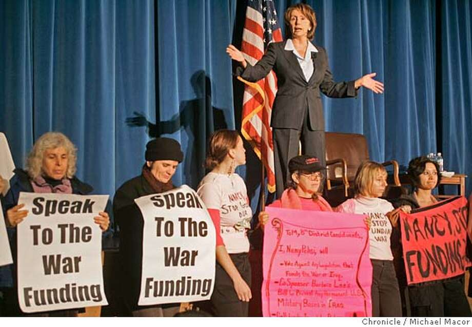"pelosi_196_mac.jpg Pelosi tries to conduct the Town Hall meeting as protesters lined the front of the stage and stayed there for the entire meeting. Protest groups were from ""Code Pink"" and ""United for Peace and Justice-Bay Area"". Congresswoman Nancy Pelosi's Townhall meeting on Iraq and national security is expected to draw 100's of citizens and some protesters, as well. Marina Middle School in the Marina District. Event in San Francisco, Ca on 1/14/06. Photo by: Michael Macor / San Francisco Chronicle Mandatory Credit for Photographer and San Francisco Chronicle/ - Magazine Out Photo: Michael Macor"