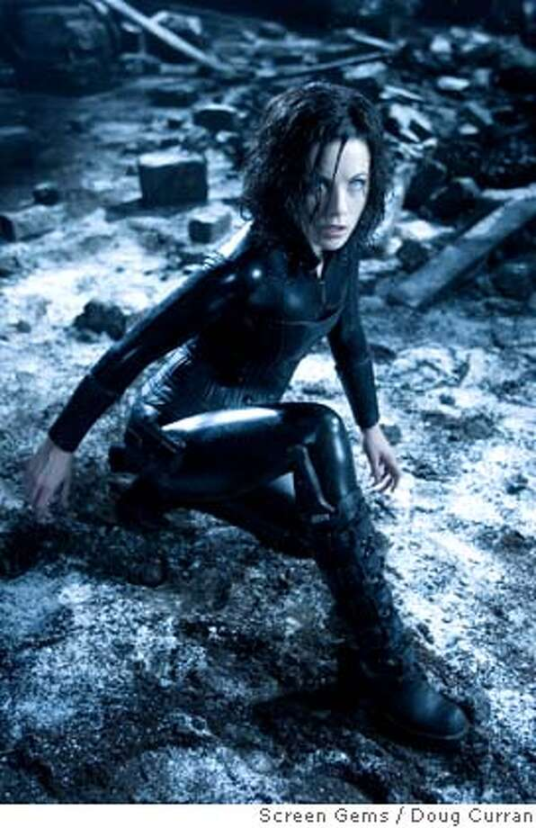 "In this photo provided by Screen Gems, Selene (Kate Beckinsale), the vampire warrior tries to unlock the secrets of her bloodline in ""Underworld: Evolution."" (AP Photo/Screen Gems/Doug Curran) Photo: DOUG CURRAN"