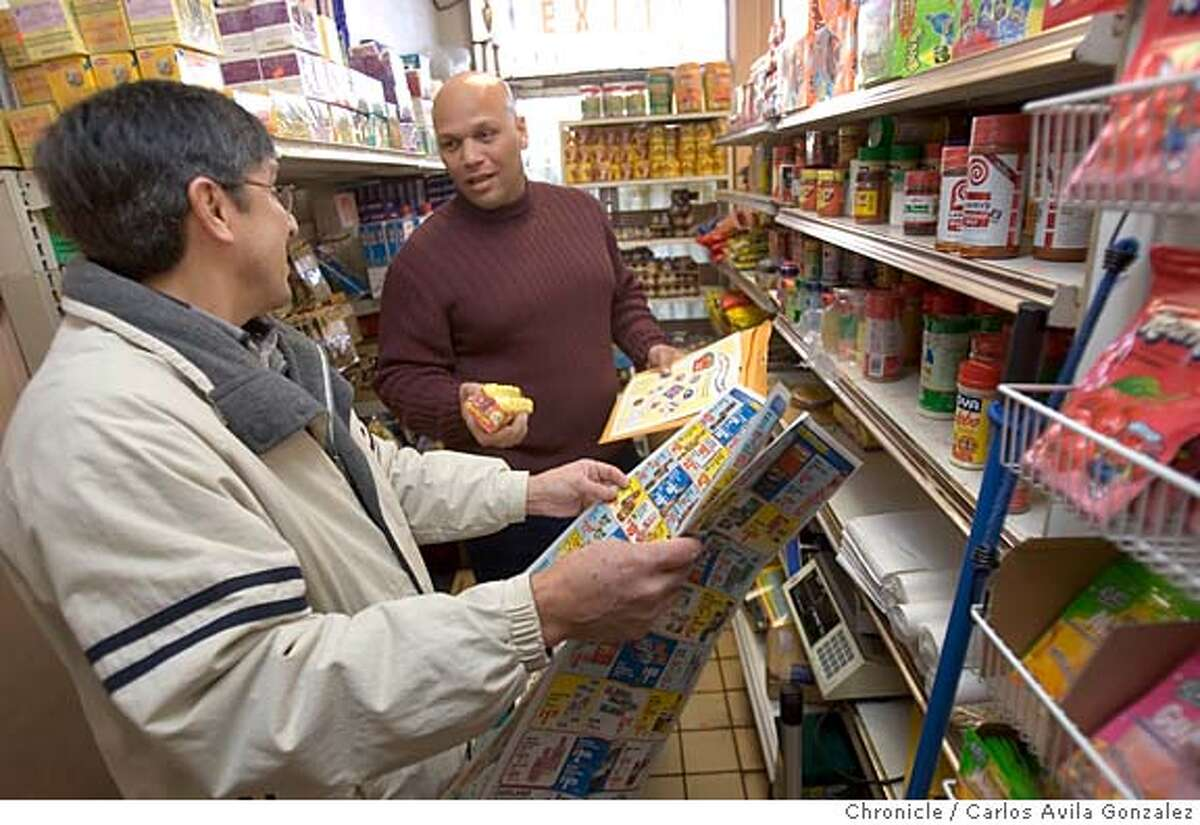GRASSHOPPERS15_005_CAG.JPG David Crosby, rear, with the Alameda County Lead Poisoning Prevention Program, speaks with Rafael Hernandez in his International Boulevard store about candies that might contain dangerous amounts of lead on Thursday, January 12, 2006, in Oakland, Ca. An assortment of several Mexican candies that are going to be tested for lead content by the program, as Oaxacans and other Mexican kids are getting lead poisoning from eating a favorite Oaxacan snack, dried grasshoppers, as well as several Mexican candies. Photo by Carlos Avila Gonzalez/The San Francisco Chronicle Photo taken on 01/12/06, in Oakland, Ca. MANDATORY CREDIT FOR PHOTOG AND SAN FRANCISCO CHRONICLE/ -MAGS OUT