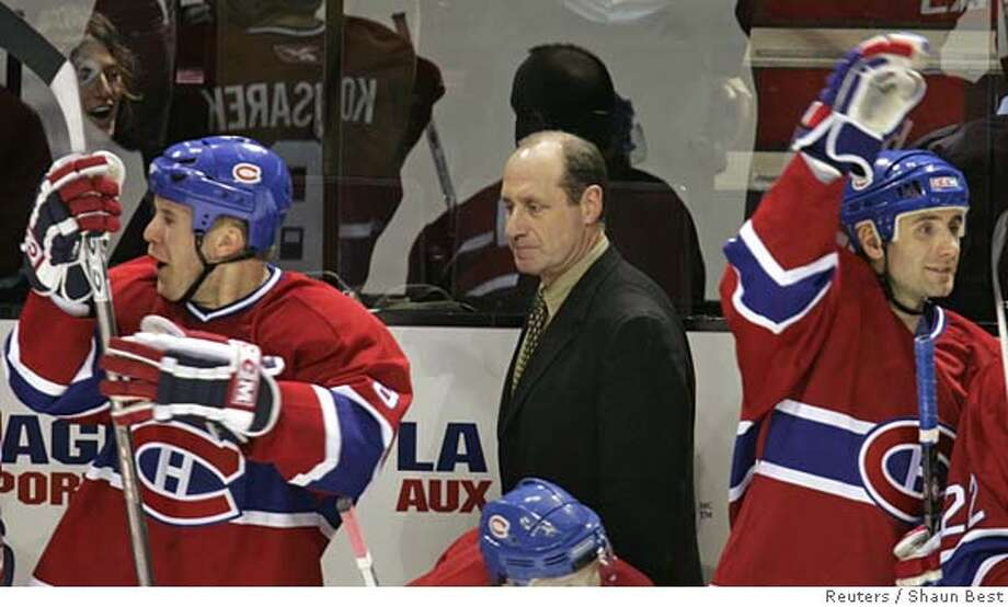 Montreal Canadiens general manager and interim head coach Bob Gainey (C) stands behind the team's bench as they celebrate a second period goal during play against the San Jose Sharks in Montreal January 14,2006. The struggling Montreal Canadiens fired head coach Claude Julien earlier on Saturday and replaced him with former star player Gainey. REUTERS/Shaun Best Ran on: 01-15-2006  Bob Gainey moved behind the bench after firing coach Claude Julien and the Canadiens responded. Photo: SHAUN BEST