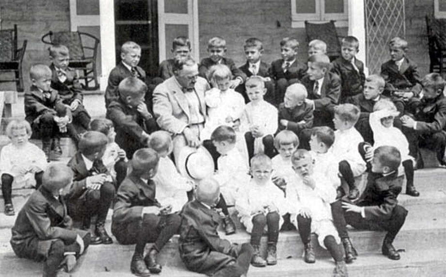 "Milton S. Hershey in 1923 with students from the Hershey Industrial School for orphan boys, to which he left his entire fortune. Photo from ""Hershey: Milton S. Hershey's Extraordinary Life of Wealth, Empire and Utopian Dreams,"" by Michael D'Antonio (Simon & Schuster; 305 pages; $25)"