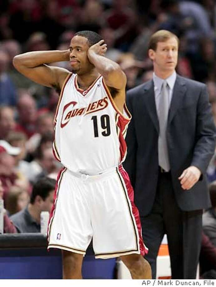 Cleveland Cavaliers' Damon Jones (19) covers his ears after sinking his only three-point shot against the Milwaukee Bucks while Bucks coach Terry Stotts looks on Saturday, Jan. 7, 2006, in Cleveland. Jones has the distinction of being the first NBA player to sign an endorsement contract with Li-Ning, an athletic shoe and sports apparel company from China. Right now, his famed jump shot is in a place far, far away, too. (AP Photo/Mark Duncan) Photo: MARK DUNCAN