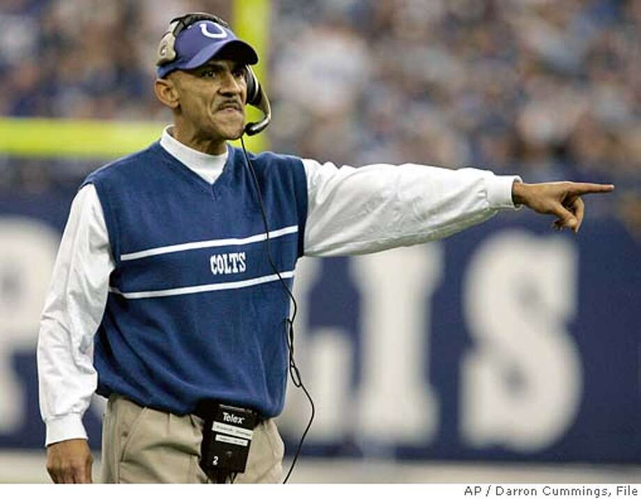 ** ADVANCE FOR WEEKEND EDITIONS, JAN. 7-9 ** Indianapolis Colts head coach Tony Dungy shouts to officials during the second quarter of their NFL football game against the San Diego Chargers in Indianapolis, Sunday, Dec. 18, 2005. The Indianapolis Colts can worry next week about their next opponent. For now, the Colts are busy enjoying the spoils of a playoff bye week _ resting, recuperating and reflecting on how to make good on coach Tony Dungy's new message. (AP Photo/Darron Cummings) A DEC. 18, 2005 PHOTO. ** ADVANCE FOR WEEKEND EDITIONS, JAN. 7-9 ** Photo: DARRON CUMMINGS