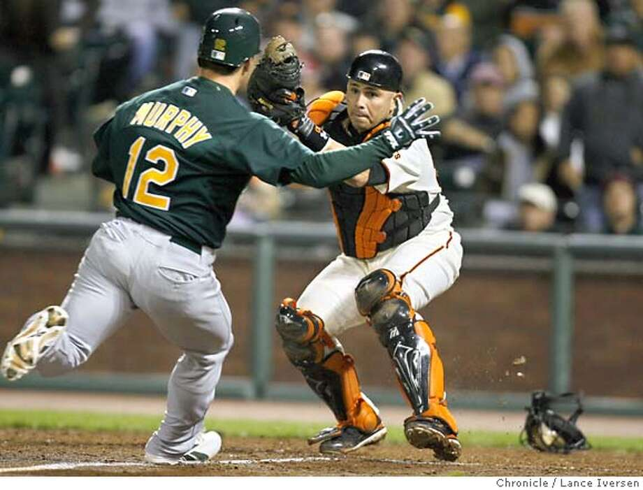 GIANTS_39572.JPG  Giants catcher Alfonzo Eliezer blocks home plate to save a score as A's Donnie Murphy charges home. San Francisco Giants vs. Oakland Athletics (June 8) (cq) SUBJECT) Lance Iversen / The Chronicle Photo taken on 6/8/07,in SAN FRANCISCO, CA. Photo: By Lance Iversen