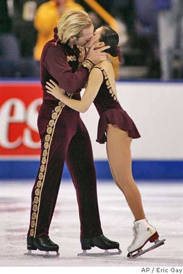 John Baldwin kisses his partner Rena Inoue after their performance in the pairs free skate program at the U.S. Figure Skating Championships in St. Louis, Friday, Jan. 13, 2006. Baldwin and Inoue finished first in the pairs competition. (AP Photo/Eric Gay) Photo: ERIC GAY