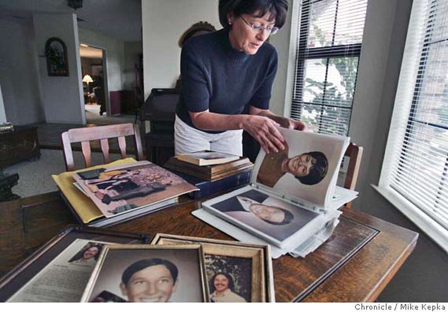 Patricia Pendergrass looks through old photographs of her brother Bryon.  Patricia Pendergrass will be attending the execution of Clarence Ray Allen who was convicted of murdering her brother Bryon Schletewitz in 1980.  Galt on 1/12/06. Mike Kepka / The Chronicle Photo: Mike Kepka
