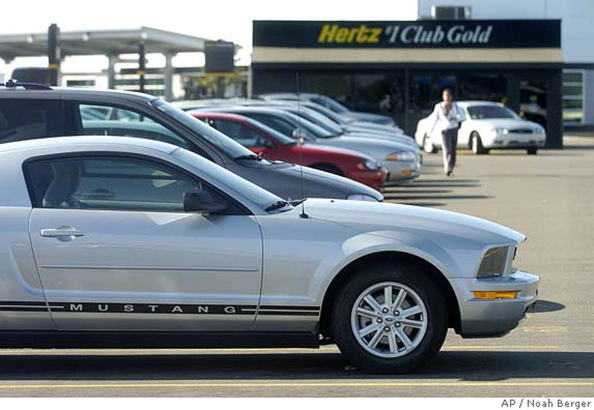 A Ford Mustang awaits a renter at an Oakland, Calif., Hertz location on Monday, Sept. 12, 2005. Hertz Corp. announced today it will sell its rental car business for $5.6 billion in cash to a private equity group composed of Clayton Dubilier & Rice, The Carlyle Group and Merrill Lynch Global Private Equity. (AP Photo/Noah Berger)