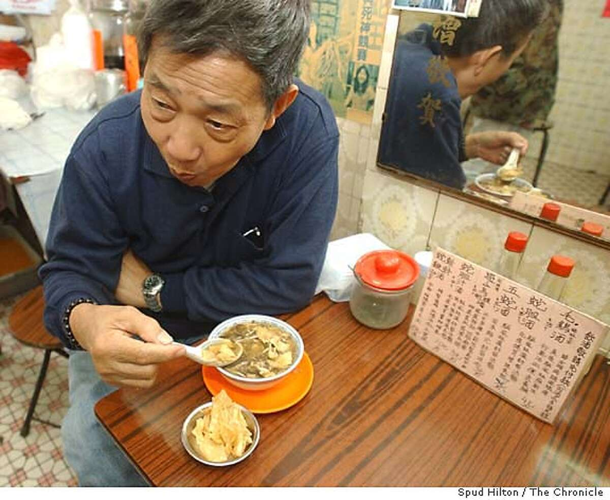 A patron eats snake soup in a restaurant in Hong Kong, Tuesday, Dec . 2, 2003. Though it's the season to tuck into a hearty bowl of snake soup but many Hong Kong restaurants are missing the main ingredient. Hong Kong's snake industry is suffering a severe supply crunch after mainland authorities banned exports during the SARS outbreak, when research suggested the respiratory illness was spread by wild game in southern China. (AP Photo/Anat Givon) When mainland authorities banned exports because of SARS, it left snake soup in short supply.
