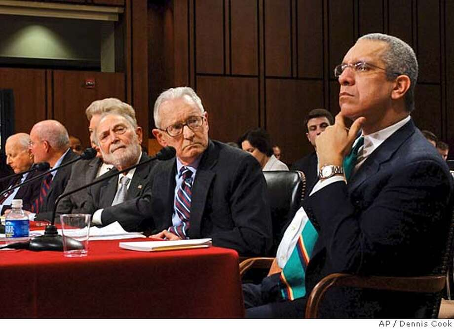 A panel of seven appellate judges who have worked with Judge Samuel Alito testify on his behalf during a Senate Judiciary Committee confirmation hearing on Capitol Hill Thursday, Jan. 12, 2006, for the Supreme Court nominee. From right, retired U.S. Court of Appeals Judge Timothy Lewis; retired U.S. Court of Appeals judge John Gibbons; Ruggero Aldisert, senior judge of the U.S. Court of Appeals in Philadelphia; Judge Maryanne Trump Barry of the U.S. Court of Appeals of Philadelphia (hidden); Anthony Scirica, chief judge of the U.S. Court of Appeals for the 3rd Circuit of Philadelphia; Edward Becker, senior judge of the U.S. Court of Appeals in Philadelphia. (AP Photo/Dennis Cook) Ran on: 01-13-2006  Appellate judges who have worked with Judge Samuel Alito on the Third Circuit testify on his behalf. Photo: DENNIS COOK
