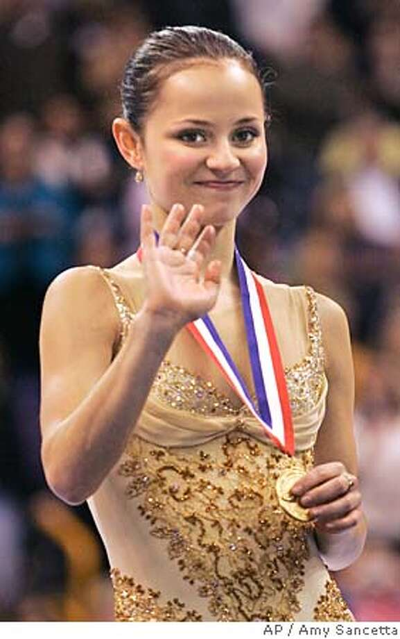 Sasha Cohen, from Corona Del Mar, Calif., shows off her gold medal after winning the ladies free skate at the U.S. Figure Skating Championships in St. Louis, Saturday, Jan. 14, 2006. Cohen earned a place on the U.S. Olympic team going to Turin. (AP Photo/Amy Sancetta) Photo: AMY SANCETTA