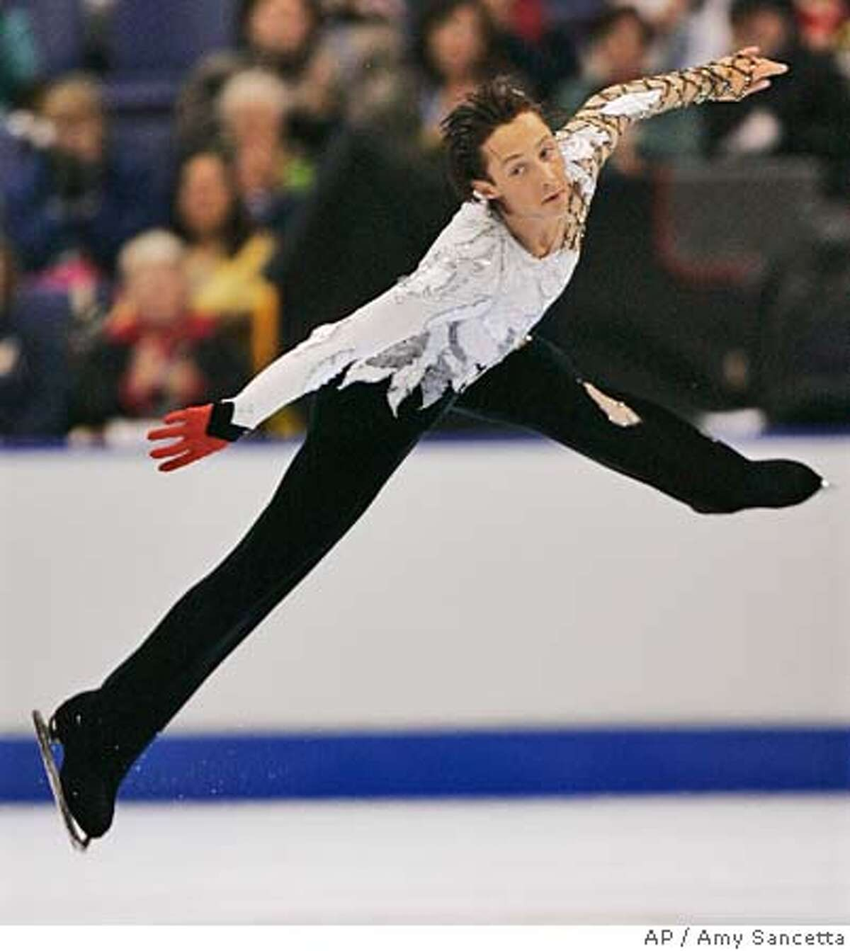 Two-time U.S. figure skating champion Johnny Weir, from Newark, Del., performs a death drop during the mens short program at the U.S. Figure Skating Championships in St. Louis, Thursday, Jan. 12, 2006. (AP Photo/Amy Sancetta) Ran on: 01-13-2006 Johnny Weir said he was thrilled at the way he skated in Thursdays short program. The long program is Saturday.