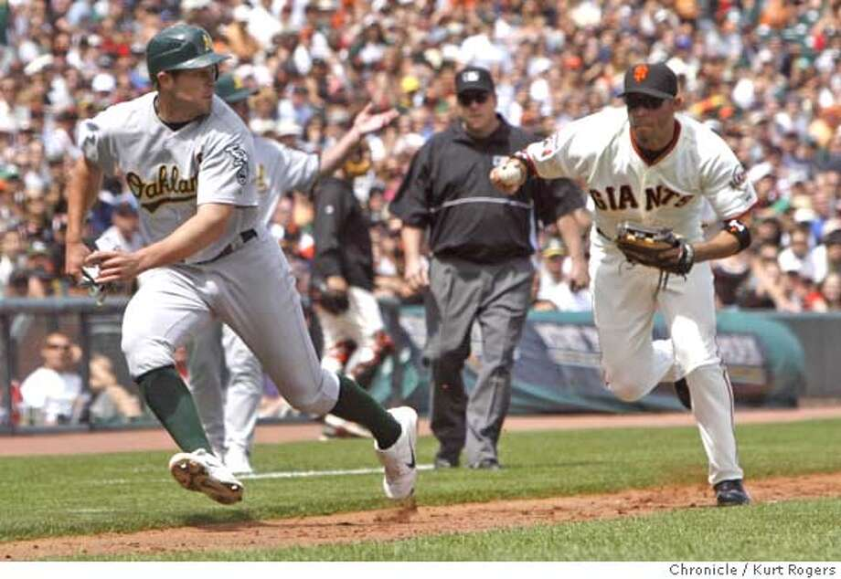 Bobby Crosby is run down by Pedro Feliz in the 7th inning.  Oakland Athletics Vs. San Francisco Giants at AT&T Park.  SATURDAY, JUNE 9, 2007 KURT ROGERS SAN FRANCISCO SFC  THE CHRONICLE GIANTS_0564_kr.jpg MANDATORY CREDIT FOR PHOTOG AND SF CHRONICLE / NO SALES-MAGS OUT Photo: KURT ROGERS