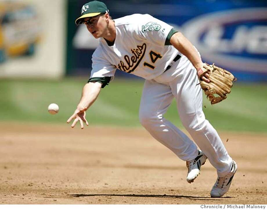 Oakland Athletics Mark Ellis tosses Cincinnati Reds Norris Hopper's ground ball to 1st base for an out in the 3rd inning.  The Oakland Athletics host the Cincinnati Reds at McAfee Coliseum in Oakland, CA on Wednesday, June 20, 2007.  Photo by Michael Maloney / San Francisco Chronicle ***roster/code replacement MANDATORY CREDIT FOR PHOTOG AND SF CHRONICLE/NO SALES-MAGS OUT Photo: Michael Maloney