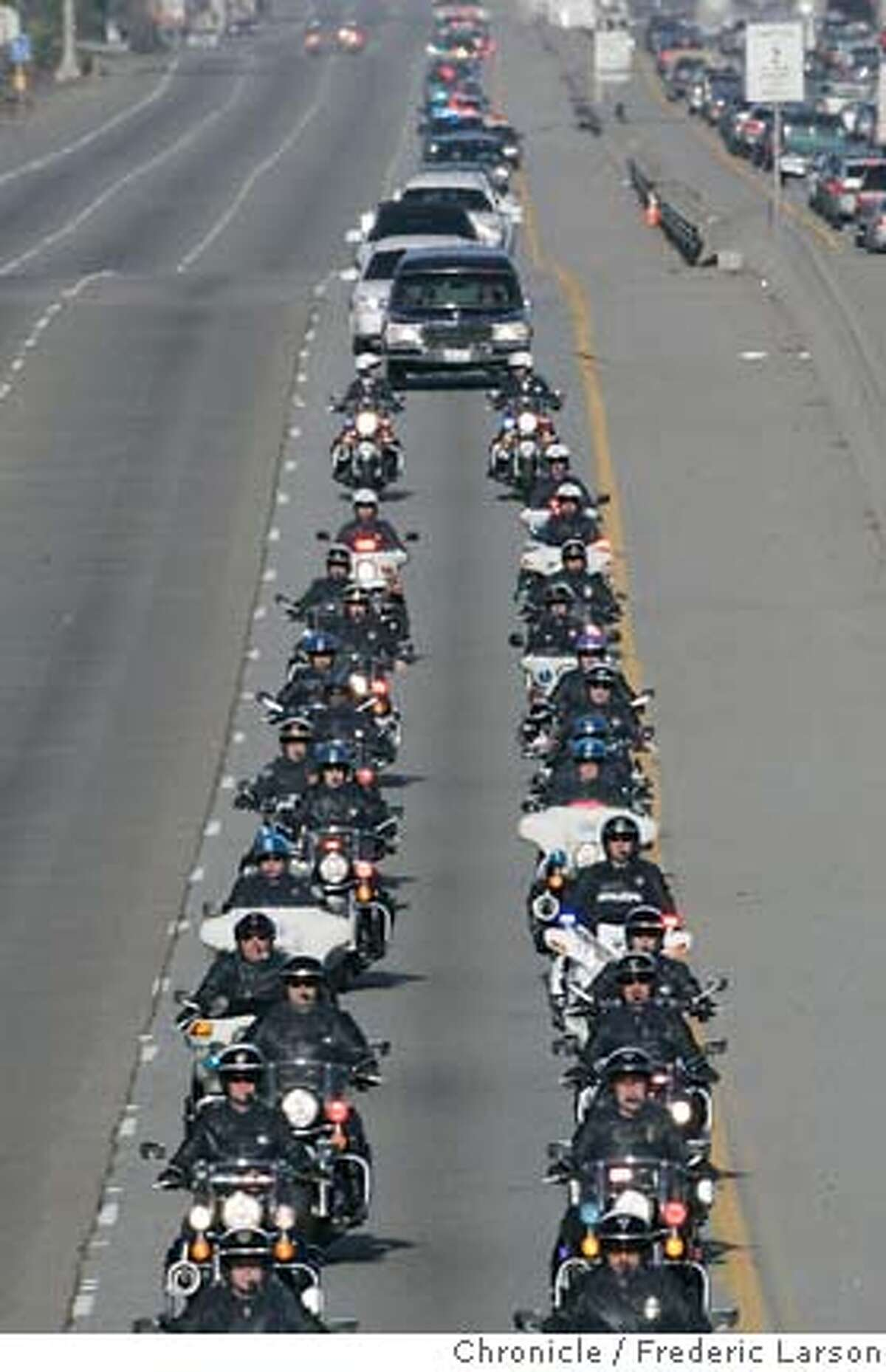 {object name} The funeral procession for slain East Palo police Officer Richard May was escorted by hundreds of officers south bound on Highway 101 from Menlo Park to downtown San Jose. 1/12/06 Frederic Larson