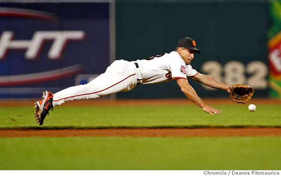 giants_313_df.jpg  Omar Vizquel makes a great diving catch and throws out Geoff Jenkins running to first in the 9th inning. The San Francisco Giants play the Milwaukee Brewers at AT&T Park. Photographed in San Francisco on 8/25/07. Deanne Fitzmaurice / The Chronicle Photo: Deanne Fitzmaurice
