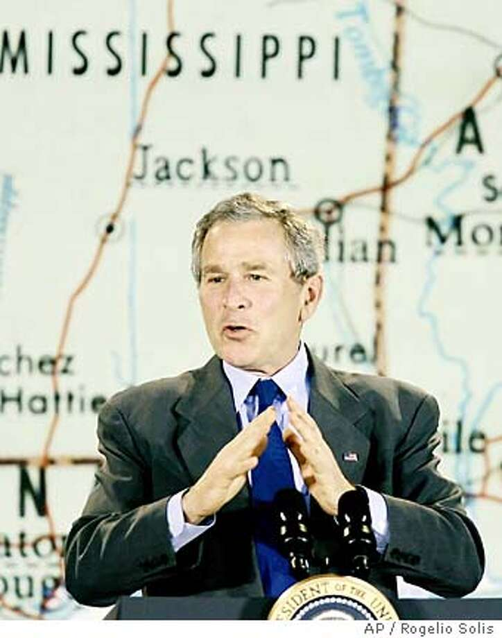 President Bush praises Gulf Coast residents for their rebuilding efforts during a visit to St. Stanislaus College in Bay St. Louis, Miss., Thursday, Jan. 12, 2006. Bush traveled to a still-ravaged Gulf Coast Thursday after three months away, promising that a building boom is on its way and encouraging other Americans to visit, too. (AP Photo/Rogelio Solis) Photo: ROGELIO SOLIS