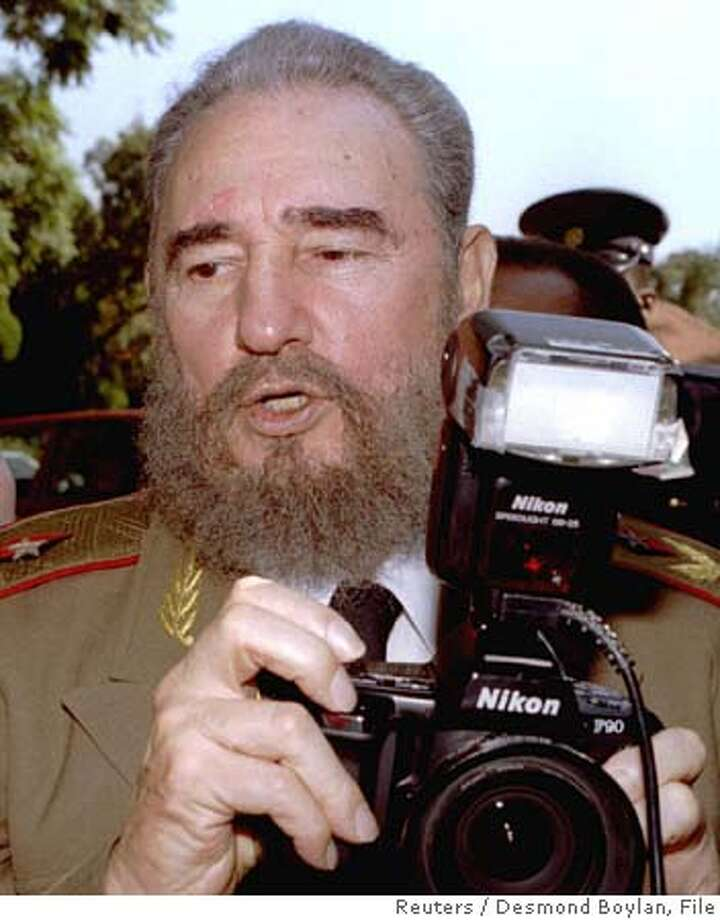 JOH06:SAFRICA;PRETORIA,10MAY94- Cuban President Fidel Castro turns the tables on photographers as he takes their picture with a borrowed camera at the Presidency building, prior to the inauguration of Nelson Mandela as the first black president of South Africa May 10. ptb/Desmond Boylan REUTER CAT Photo: Desmond Boylan