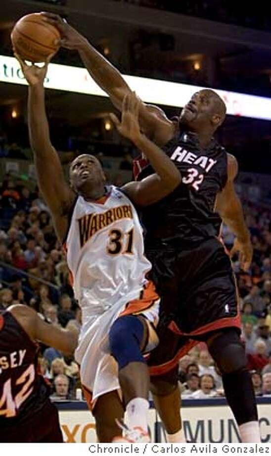 Warriors Adonal Foyle has his shot blocked in the first half by Shaquille O'Neal. Golden State Warriors played the Miami Heat at the Oakland Arena on Wednesday, January 11, 2006.  Photo by Carlos Avila Gonzalez / The San Francisco Chronicle  Photo taken on 1/11/06 in Oakland, CA. Photo: Carlos Avila Gonzalez