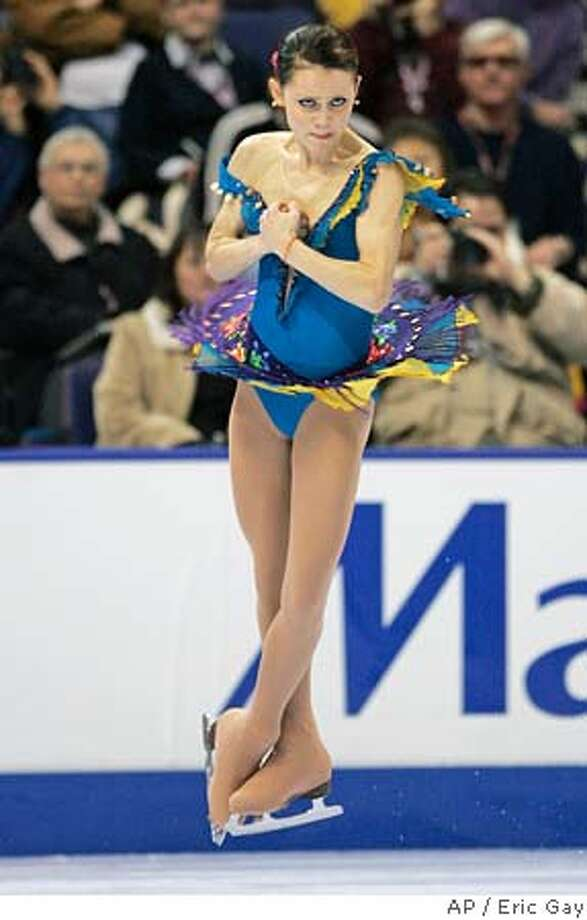 Silver medalist in the 2005 World Championships, Sasha Cohen, from Corona Del Mar, Ca., leaps into an axel during the womens short program at the U.S. Figure Skating Championships in St. Louis, Thursday, Jan. 12, 2006. (AP Photo/Eric Gay) Ran on: 01-13-2006  Sasha Cohen leaps into an axel during the women's short program, where she took a comfortable lead with 65.15 points. Photo: ERIC GAY