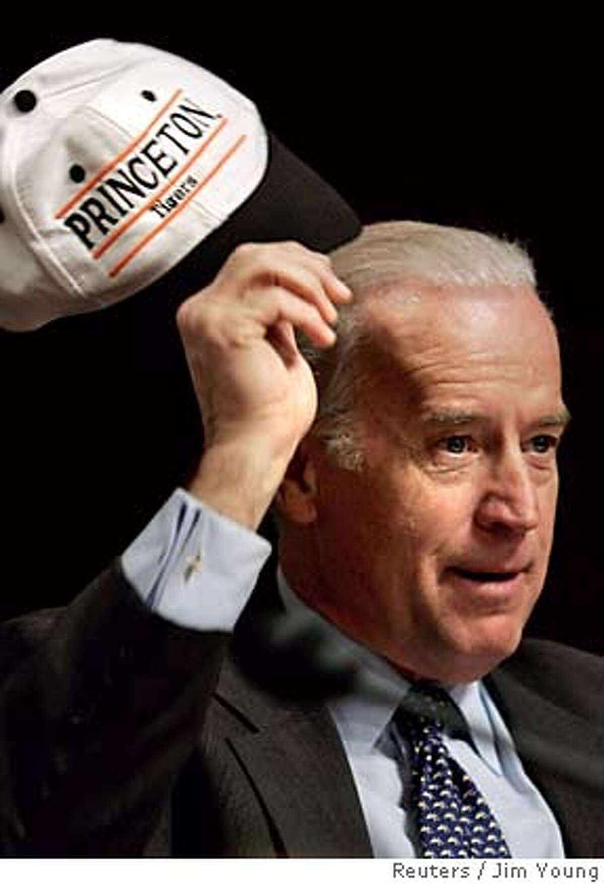 U.S. Senator Joseph Biden (D-DE) shows off a Princeton University cap as he asks questions of Judge Samuel Alito on the third day of Alito's Senate Judiciary Committee confirmation hearing for the U.S. Supreme Court on Capitol Hill in Washington January 11, 2006. Democratic party senators have criticized Alito's inability to recall details about his membership � which he listed on a Reagan administration job application in the 1980's � in a conservative organization that opposed the admission of women and minorities at Princeton University. REUTERS/Jim Young 0