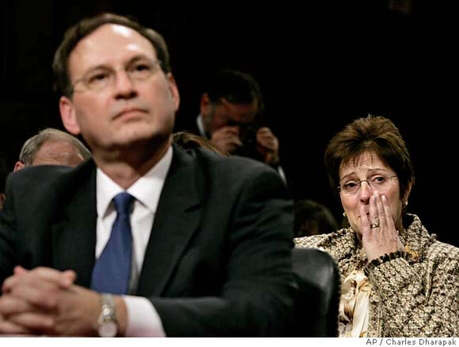 Martha-Ann Alito, right, reacts during the intense questioning of her husband Judge Samuel Alito on the third day of his Senate Judiciary Committee confirmation hearings on Capitol Hill in Washington, Wednesday, Jan. 11, 2006. (AP Photo/Charles Dharapak) Photo: CHARLES DHARAPAK