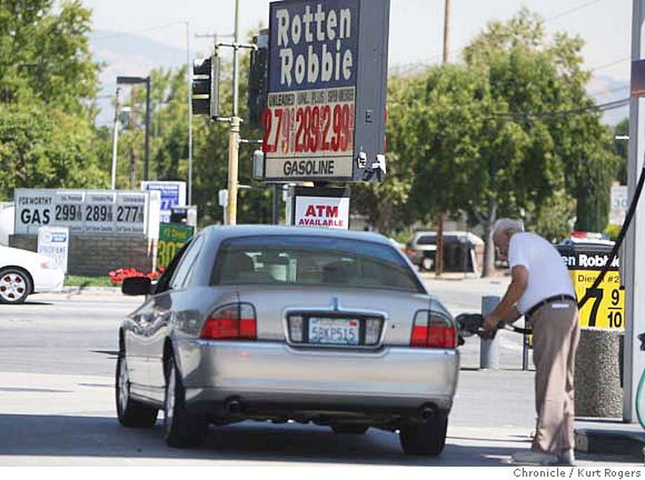 Bob Baisa of San Jose fills up at a Rotten Robbie at the corner of Meridian and Foxworthy where the gas was 279 a gallon for regular. Bob said that it was two cents lower yesterday. THURSDAY, AUG 30, 2007 KURT ROGERS SAN JOSE SFC  THE CHRONICLE GASPRICES_042_kr.jpg MANDATORY CREDIT FOR PHOTOG AND SF CHRONICLE / NO SALES-MAGS OUT Photo: KURT ROGERS