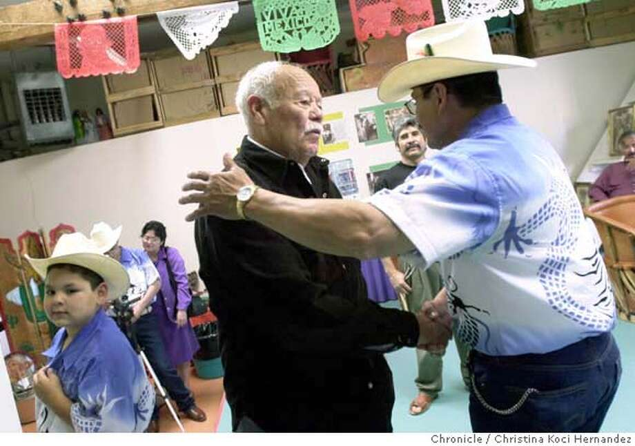 VILLA15g-C-14SEP02-MT-CKH  CHRISTINA KOCI HERNANDEZ/CHRONICLE  Pancho Villas son, Ernesto Nava, (L) is greeted by (R)Jose Trujillo, whose family band, Los Trujillo will perform for him, is honored at a reception at Corazon del Pueblo, in Oakland.On far left is Jose Trujillo, as well, a smaller version, member of the family band. CAT Photo: CHRISTINA KOCI HERNANDEZ