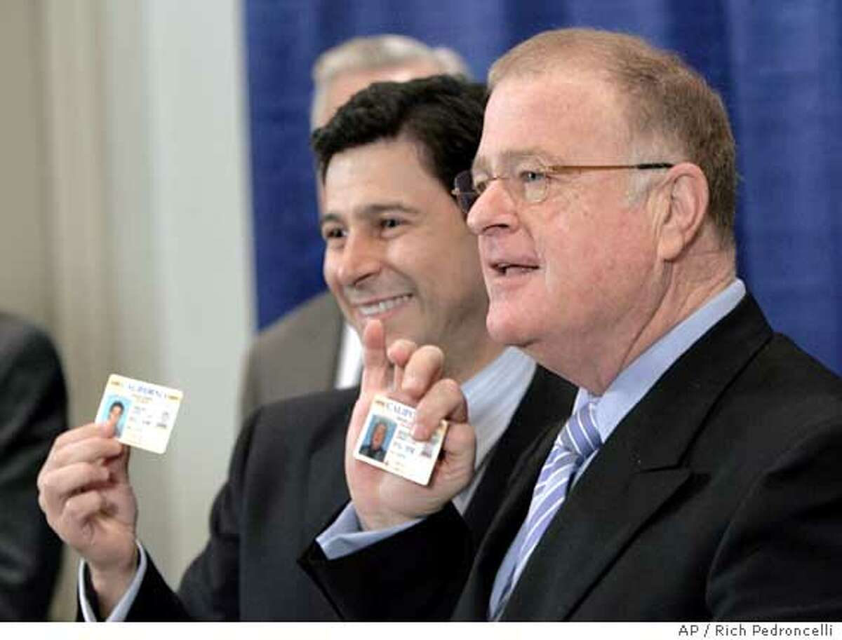 Assembly Speaker Fabian Nunez, D-Los Angeles, left, and state Sen. President Pro Tem Don Perata, D-Oakland, right, hold up their driver's licenses to show they have valid licenses during a news conference in Sacramento, Calif., Tuesday, Jan. 10, 2006. The response by the two Demcratic lawmakers was in reference to the motorcycle accident Gov. Arnold Schwarzenegger was involved in over the weekend where it was revealed that the governor did not have a proper motorcycle license. (AP Photo/Rich Pedroncelli) Ran on: 01-11-2006 The governor shows off his lip, which required 15 stitches, on Monday. By Tuesday, in the top photo, it had healed a bit. Ran on: 01-11-2006 The governor shows off his lip, which required 15 stitches, on Monday. By Tuesday, in the photo at top, it had healed a bit.