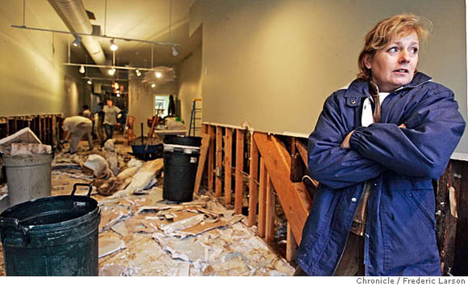 """WEATHER_0408_fl.jpg Holly Hopper, owner of a home furnituring store called """"Grasshopper"""" on San Anselmo Ave in San Anselmo has no flood insurance and now has to start all over from the damage from the lastest rains. The Bay Area weather forecast sounds familiar -- lots of rain and wind. A storm was heading today and was expected to dump at least 2 inches of rain on Napa and Sonoma counties and the Santa Cruz Mountains today before tapering off Tuesday, according to the National Weather Service. 1/2/06 San Anselmo CA Frederic Larson San Francisco Chronicle Photo: Frederic Larson"""