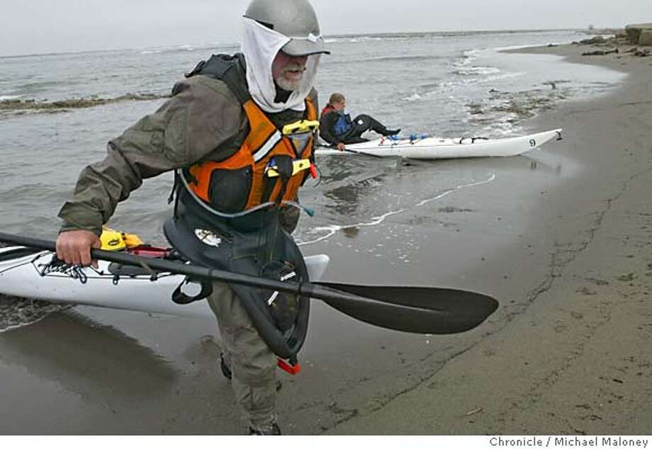 NCOAST_EEL_005_MJM.jpg Paul McHugh drags his kayak up the beach as Bo Barnes gets out of his after an 18 mile paddle to the mouth of the Eel River.  Today's paddle took the kayakers from Eureka to the mouth of the Eel River, approx 18 miles.  Rediscovering California's North Coast. A kayak voyage by Paul McHugh, Bo Barnes and John Weed. A paddle from the Oregon border to the SF bay.  Photo taken on 9/18/05 in Fortuna, CA by Michael Maloney / San Francisco Chronicle MANDATORY CREDIT FOR PHOTOG AND SF CHRONICLE/ -MAGS OUT Photo: Michael Maloney