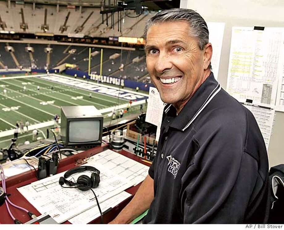 ** FILE ** St. Louis Rams radio announcer Jack Snow sits in the booth before the Rams' Monday night football game against the Indianapolis Colts in this Oct. 17, 2005 file photo, in St. Louis. Snow, a wide receiver for the Los Angeles Rams for 11 seasons and a Rams broadcaster for several years, died Monday night, Jan. 9, 2006, the team has confirmed. (AP Photo/Bill Stover) AN OCT. 17, 205, PHOTO Photo: BILL STOVER