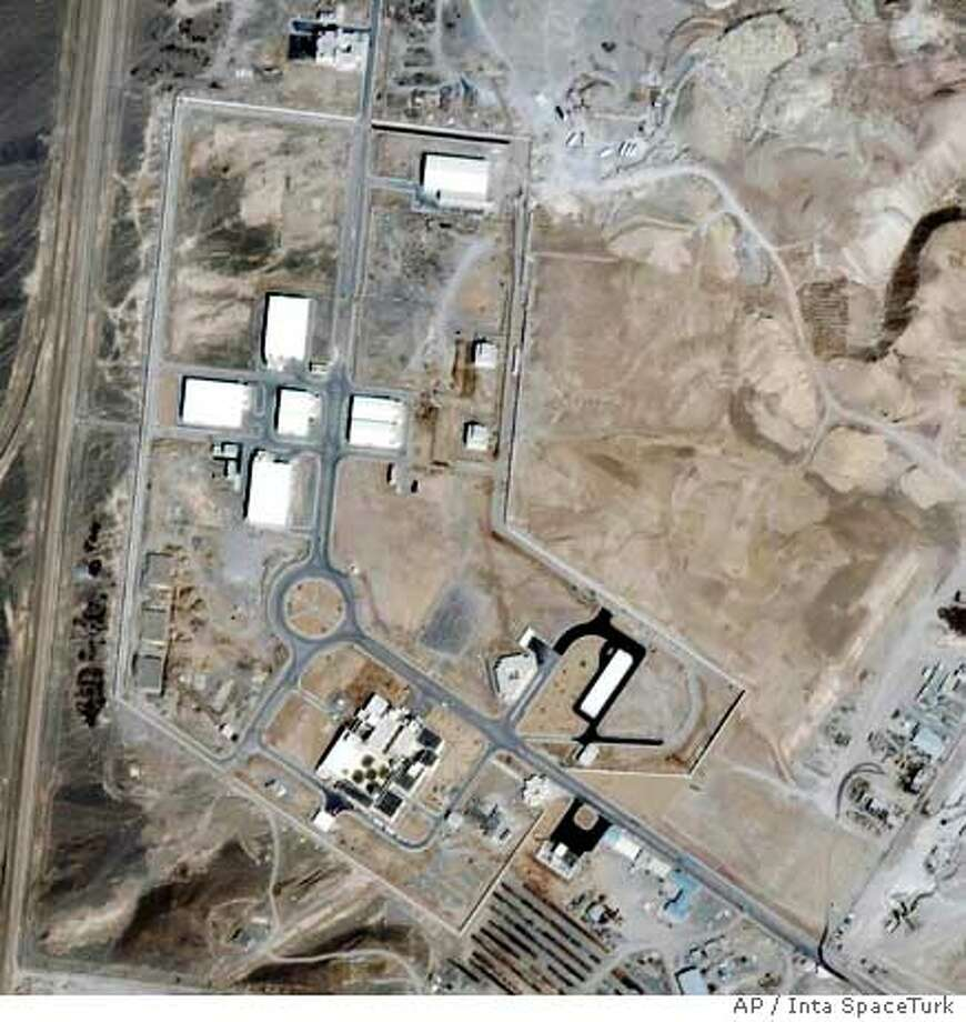 ** FILE ** This recent undated satellite image provided by Space Imaging/Inta SpaceTurk shows the once-secret Natanz nuclear complex in Natanz, Iran, about 150 miles south of Tehran. Iran broke U.N. seals on its nuclear enrichment facility Tuesday, Jan. 10, 2006 pledging only to conduct research, but the international nuclear watchdog said Tehran also planned small-scale enrichment of uranium _ a process that can produce fuel for nuclear weapons. (AP Photo/Space Imaging/Inta SpaceTurk, HO) Ran on: 01-11-2006  A recent satellite image shows the once-secret Natanz nuclear complex in Natanz, Iran, about 150 miles south of Tehran. Ran on: 01-11-2006  A recent satellite image shows the once-secret Natanz nuclear complex in Natanz, Iran, about 150 miles south of Tehran. Photo: X