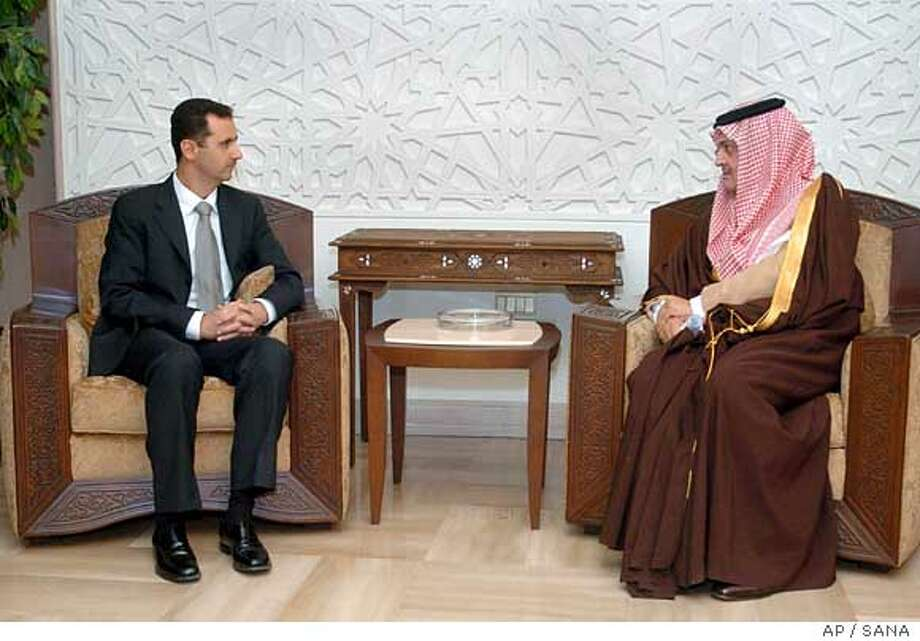 Syrian President Bashar Assad, left, meets Saudi Foreign Minister Saud al-Faisal in Damascus on Sunday, Jan. 8, 2006. The Saudi minister told reporters that his visit was to prepare for Syrian President Bashar Assad who is expected to fly to Saudi Arabia later Sunday for talks with top Saudi leaders.(AP Photo Sana). Ran on: 01-09-2006  Syria's President Bashar Assad (left) meets with Saudi Foreign Minister Saud al-Faisal. Photo: SANA