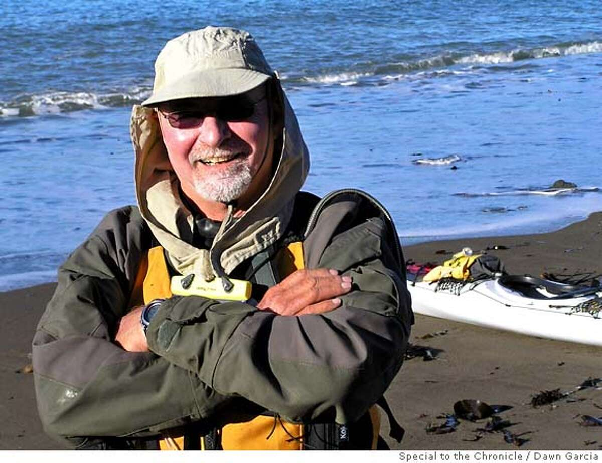 SLUG: 'swansong' CAP: 'Paul McHugh in his ocean paddling outfit, just before launch from the beach at Fort Ross. He's smiling because the end of his 40-day expedition from Oregon to San Francisco is starting to come into view.