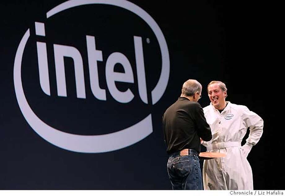 Apple Computer CEO Steve Jobs (left) announces using the Intel processor in his keynote speech at the Macworld Expo in San Francisco's Moscone Center. Photographed by Liz Hafalia on 1/10/06 in San Francisco, California. SFC Photo: Liz Hafalia