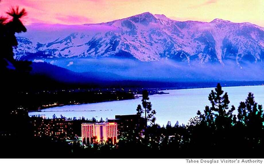 TRAVEL SOUTH LAKE TAHOE -- A sunset overview of the south shore of Lake Tahoe, Nev., showing Caesars Tahoe hotel and casino in 2003. Photo courtesy Tahoe Douglas Visitor's Authority Photo: HO