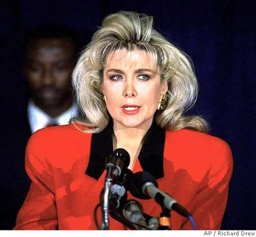 ** FILE ** Gennifer Flowers speaks to reporters in New York, in this Jan. 27, 1992 file photo. A federal appeals court in San Francisco announced Tuesday, Nov. 12, 2002, that it plans to reinstate Flowers' defamation and conspiracy suit against Sen. Hillary Rodham Clinton and former presidential aides George Stephanopoulos and James Carville. The court said Flowers should have her day in court to try to prove the aides fouled her reputation when they publicly accused her of doctoring audio tapes between Flowers and Bill Clinton. (AP Photo/Richard Drew, File) Photo: RICHARD DREW