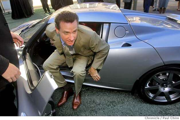 Mayor Gavin Newsom climbs out of the Tesla Roadster electric car after a test drive when it was unveiled at a Hyatt Hotel in San Francisco, Calif. on Wednesday, August 29, 2007. The hotel chain announced plans to install several power stations at select hotels that will recharge the $98,000 vehicle.  PAUL CHINN/The Chronicle MANDATORY CREDIT FOR PHOTOGRAPHER AND S.F. CHRONICLE/NO SALES - MAGS OUT Photo: PAUL CHINN