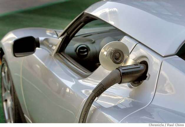 The Tesla Roadster electric car was plugged into a charger before it was unveiled at a Hyatt Hotel in San Francisco, Calif. on Wednesday, August 29, 2007. The hotel chain announced plans to install several power stations at select hotels that will recharge the $98,000 vehicle.  PAUL CHINN/The Chronicle MANDATORY CREDIT FOR PHOTOGRAPHER AND S.F. CHRONICLE/NO SALES - MAGS OUT Photo: PAUL CHINN