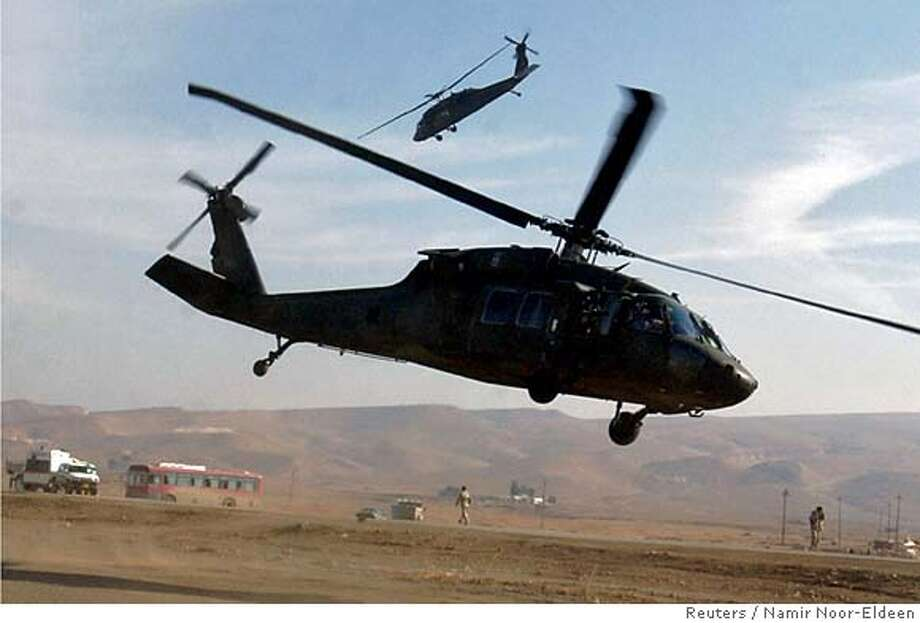 U.S. UH-60 Black Hawk helicopters fly near the U.S. military base in Mosul, north of Baghdad January 4, 2006. A U.S. UH-60 Black Hawk helicopter crashed in northern Iraq on Saturday night, killing all 12 aboard in one of the worst incidents of its kind since the war began in 2003, the U.S. military said on Sunday. Picture taken January 4, 2006. REUTERS/Namir Noor-Eldeen Ran on: 01-09-2006  The UH-60 Black Hawk that crashed was similar to these flying near the U.S. military base in Mosul, in northern Iraq, last Wednesday. Photo: NAMIR NOOR-ELDEEN