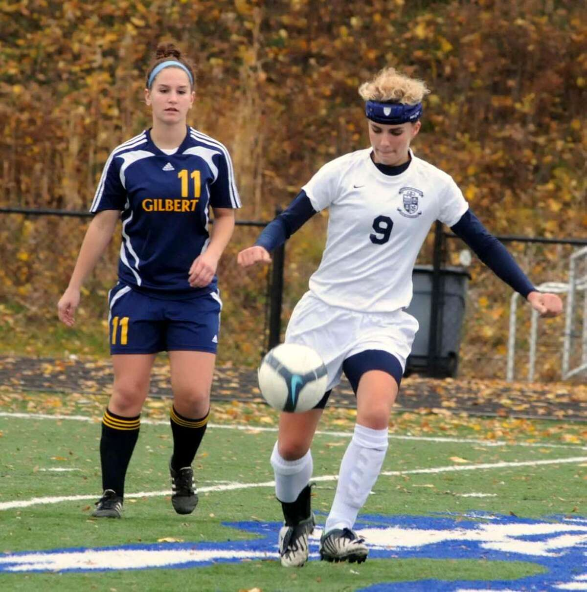 Immaculate's Jen Daily, right, has possession of the ball while Gilbert's Jackie Vaccari comes up from behind at the 2009 Girls Soccer Class S Quarterfinals on Friday Nov.13 at Immaculate High School in Danbury CT. Immaculate vs Gilbert High School, Winsted, CT.