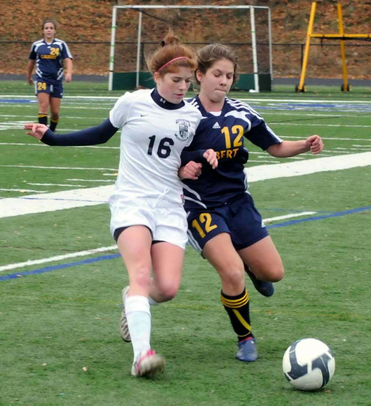 Immaculate's Sarah Murtha, left, and Gilbert's Rachel Wendal struggle against each other to gain possession of the ball at the 2009 Girls Soccer Class S Quarterfinals on Friday Nov.13 at Immaculate High School in Danbury CT. Immaculate vs Gilbert High School, Winsted, CT.