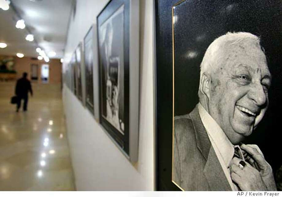 A picture of Israeli Prime Minister Ariel Sharon from 1997 hangs on the wall as part of a historical gallery in a hallway at the Knesset, or Israel's parliament, in Jerusalem, Sunday, Jan. 8, 2006. Doctors will start bringing Prime Minister Ariel Sharon out of his medically induced coma on Monday, provided there are no changes in his condition, hospital officials said Sunday. (AP Photo/Kevin Frayer) Ran on: 01-09-2006  A portrait of Israeli Prime Minister Ariel Sharon from 1997 hangs on the wall as part of a historical gallery in a corridor at the Knesset, or Israel's parliament, in Jerusalem. Photo: KEVIN FRAYER