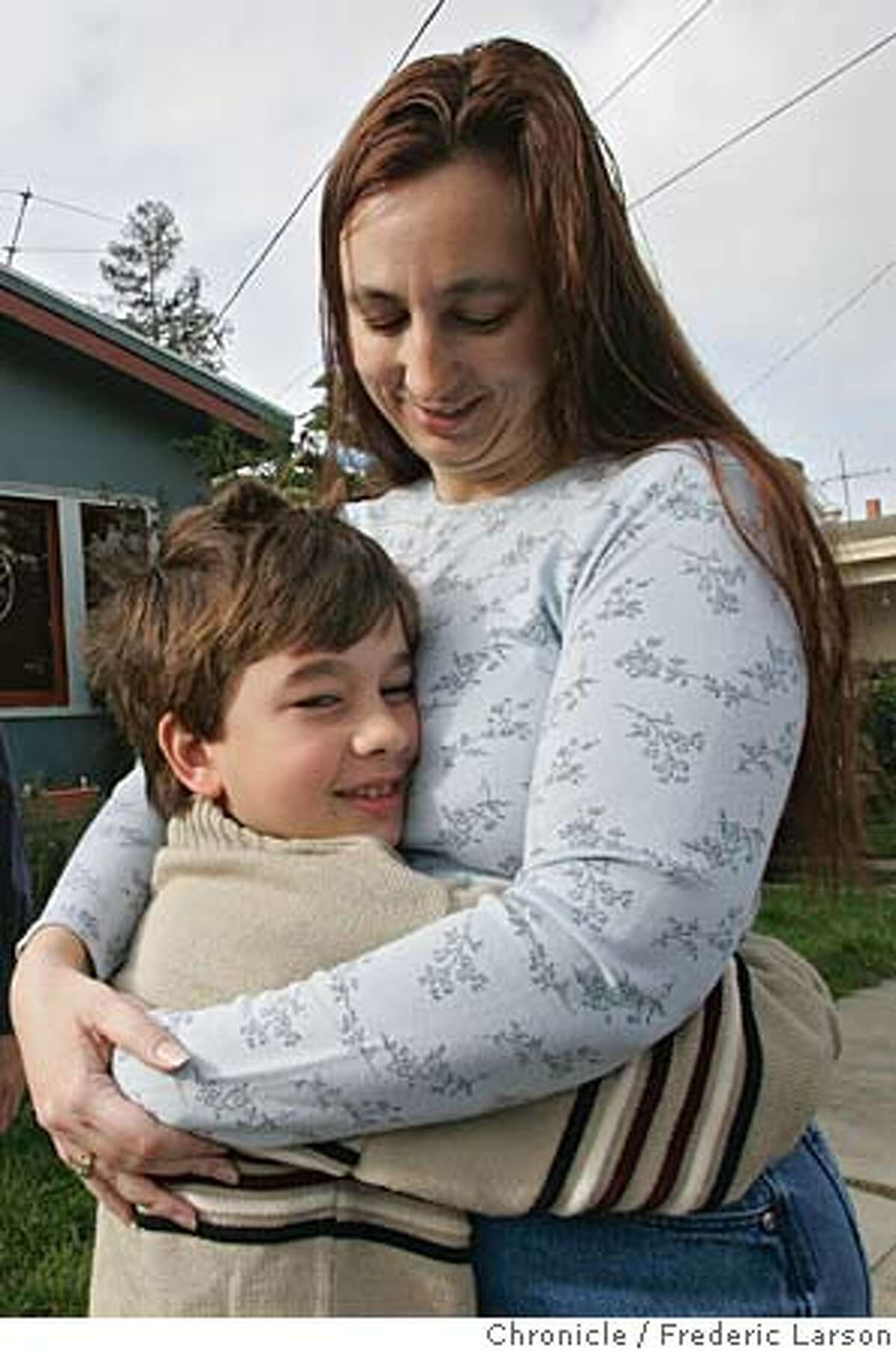 SAVINGS_0051_fl.jpg Sue McCullough gets a warm hug form her son Alec (8) Braks outside their home in Oakland. They are examples of people who fell into debt and pulled themselves out. They are the kicker anecdote in a story called SAVINGS30 that says -- Americans ain't saving. 12/26/05 Oakland CA Frederic Larson San Francisco Chronicle