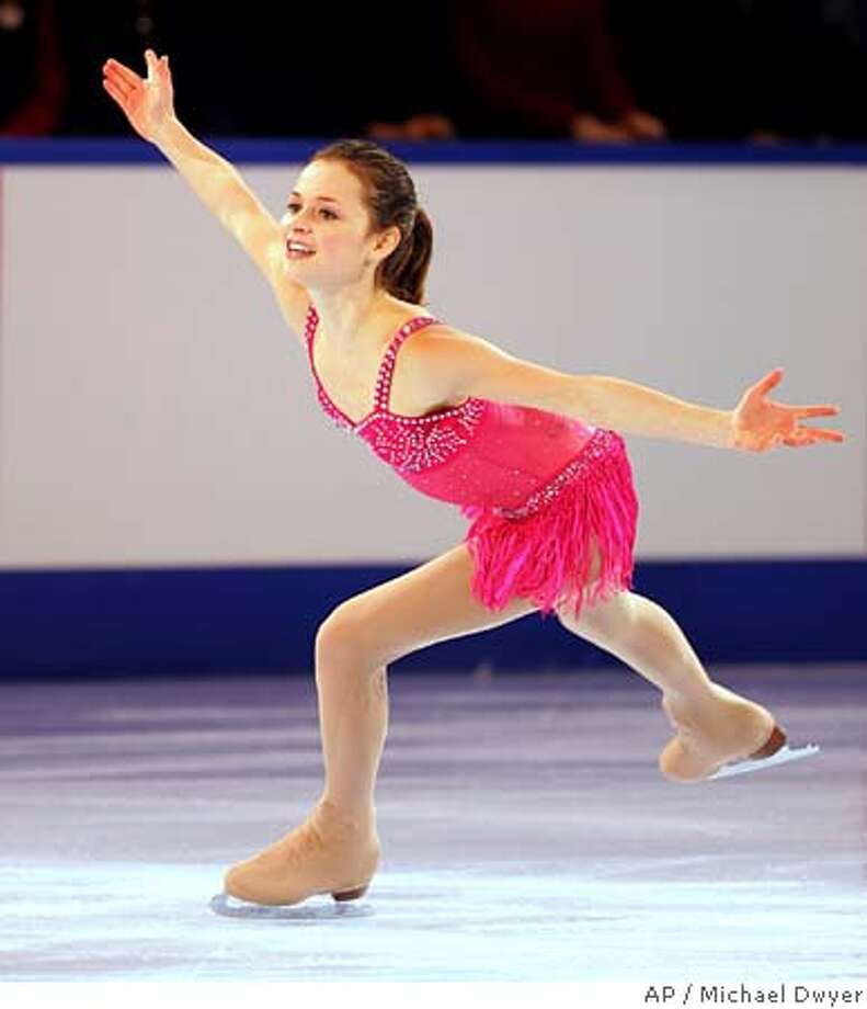 ** ADVANCE FOR WEEKEND EDITIONS, JAN. 7-9 ** Sasha Cohen performs in the Marshalls US Figure Skating Challenge in Boston, in this Dec. 11, 2005 photo. Sasha Cohen's days of chasing after Michelle Kwan at the U.S. Figure Skating Championships are over. With Kwan injured and missing nationals for the first time since the early 1990s, someone else is guaranteed to replace her atop the podium. And, sorry Kimmie Meissner, Alissa Czisny and everybody else, Cohen is the heir apparent when nationals begin Tuesday in St. Louis. (AP Photo/Michael Dwyer) ** ADVANCE FOR WEEKEND EDITIONS, JAN. 7-9 ** A DEC. 11, 2005 PHOTO Photo: MICHAEL DWYER