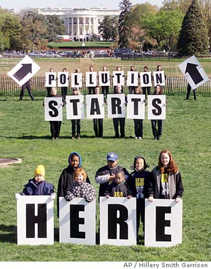 Demonstrators pose for a photo during a Greenpeace rally on the Ellipse in Washington Wednesday, April 18, 2001. Just in time for Eart Day on Sunday, President Bush issued good news to environmentalists. But as this protest shows, it will take far more than that to reassure conservation groups who say they've been steamrolled by a list of industry-friendly actions from the new administration. (AP Photo/ Hillery Smith Garrison) Ran on: 01-08-2006  Environmental activists once favored demonstrations like this Greenpeace rally at the White House, but now many play down grandstanding in favor of shaking hands with enlightened executives. Photo: HILLERY SMITH GARRISON