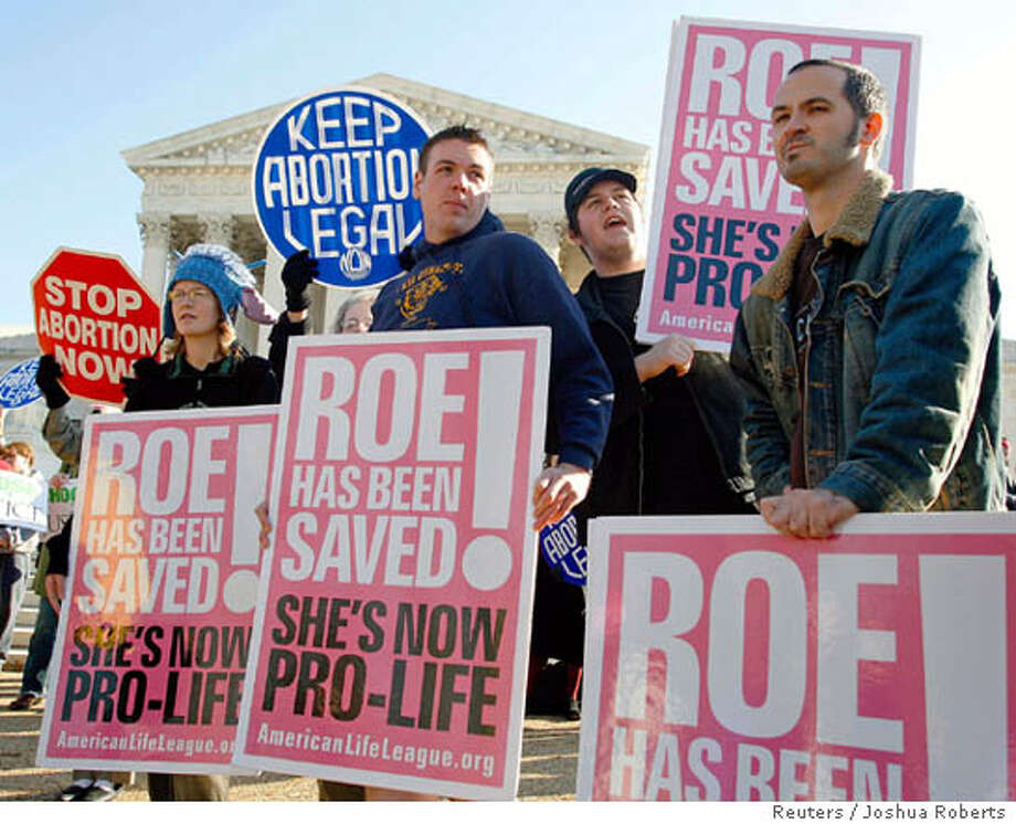 Anti-abortion protesters rally as the U.S. Supreme Court hears its first abortion case in five years in Washington November 30, 2005. The court will hear arguments on one of its most contentious issues when it considers a state law requiring notification of a parent before a minor can end her pregnancy. REUTERS/Joshua Roberts Ran on: 12-01-2005  Protesters rallied at the Supreme Court building as justices heard arguments in the court's first major abortion case in five years. 0 Photo: JOSHUA ROBERTS