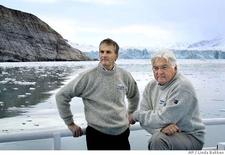"Norwegian foreign minister Jonas Gahr Stoere, left and his German counterpart Frank-Walter Steinmeier, right onboard the research vessel ""Lance"" in Kongsfjorden off the coast of the Norwegian arctic island, Svalbard Tuesday Aug. 28, 2008. (AP Photo/Linda Bakken, Kings Bay AS, SCANPIX) Photo: Linda Bakken"